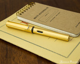 Lamy LX Fountain Pen - Gold - On Notebook