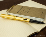 Lamy LX Fountain Pen - Gold - On Notebook Posted