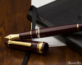 Sailor 1911 Realo Fountain Pen - Maroon with Gold Trim - Open on Notebook
