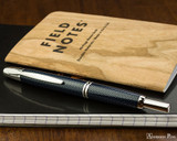 Pilot Vanishing Point Fountain Pen - Blue Carbonesque - Closed on Notebook