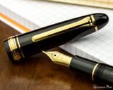 Sailor 1911 Large Fountain Pen - Black with Gold Trim - Open on Desk