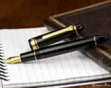 Sailor 1911 Large Fountain Pen - Black with Gold Trim - Open on notebook 2