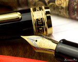 Sailor Pro Gear King of Pen Fountain Pen - Black with Gold Trim - Nib on Notebook