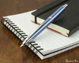 Pilot Vanishing Point Decimo Fountain Pen - Light Blue - Open on Notebook