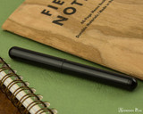 Kaweco Liliput Fountain Pen - Black - Closed on Notebook