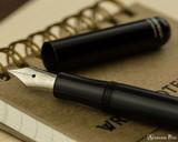 Kaweco Liliput Fountain Pen - Black - Open on Notebook