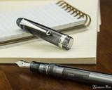 Pilot Custom 74 Fountain Pen - Smoke - Open on Notebook