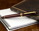 Sailor 1911 Large Fountain Pen - Maroon with Gold Trim - Closed on Notebook