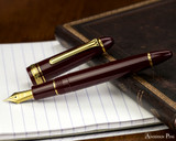 Sailor 1911 Large Fountain Pen - Maroon with Gold Trim - Open on Notebook