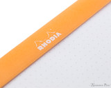 Rhodia No. 18 Staplebound Notepad - A4, Dot Grid - Orange perforation deatil