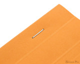 Rhodia No. 18 Staplebound Notepad - A4, Dot Grid - Orange staple closeup