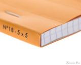 Rhodia No. 18 Staplebound Notepad - A5, Graph - Orange binding closeup