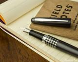 Pilot Metropolitan Fountain Pen - Retro Pop Gray - Open on Notebook
