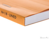 Rhodia No. 18 Staplebound Notepad - A4, Lined - Orange binding detail