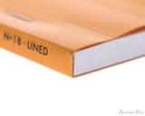Rhodia No. 18 Staplebound Notepad - A4, Lined - Orange binding detail