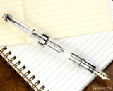 Sailor Pro Gear Fountain Pen - Transparent with Rhodium Trim - Posted onNotebook