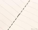 Clairefontaine Flying Spirit Notebook - A5, Lined - Black center stitching closeup
