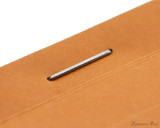 Rhodia No. 11 Staplebound Notepad - 3 x 4, Graph - Orange staple detail