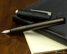 Faber-Castell Loom Gunmetal Matte Fountain Pen - Open on Notebook