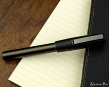 Faber-Castell Loom Gunmetal Matte Fountain Pen - Closed on Notebook