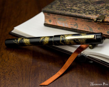 Namiki Chinkin Fountain Pen - Pine Tree - Closed On Notebook