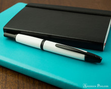 Pilot Vanishing Point Fountain Pen - White with Matte Black Trim - Closed on Notebook