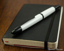 Pilot Vanishing Point Fountain Pen - White with Matte Black Trim - Closed on Notebook 2