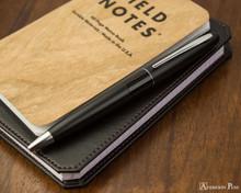 Pilot Metropolitan Ballpoint - Black Plain - On Notebook
