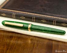 Platinum 3776 Celluloid Fountain Pen - Jade - Closed on Notebook