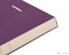 Rhodia No. 18 Premium Notepad - A4, Lined - Purple binding detail