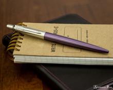 Parker Jotter Ballpoint - Victoria Violet - On Notebook