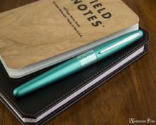 Pilot Metropolitan Fountain Pen - Retro Pop Turquoise - Closed on Notebook