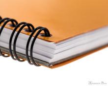 Rhodia No. 16 Wirebound Notepad - A5, Dot Grid - Orange binding detail