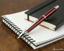 Pilot Vanishing Point Decimo Fountain Pen - Burgundy - Open on Notebook