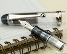Pilot Custom 74 Fountain Pen - Clear - Nib on Notebook