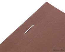 Rhodia No. 16 Premium Notepad - A5, Lined - Chocolate staple detail
