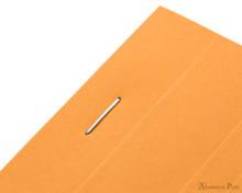 Rhodia No. 16 Staplebound Notepad - A5, Blank - Orange staple detail