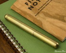 Kaweco Liliput Supra Fountain Pen - Brass - Closed on Notebook
