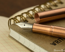 Kaweco Liliput Fountain Pen - Copper - Nib on Notebook