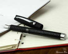 Faber-Castell Essentio Black Leather Fountain Pen - Open on Notebook