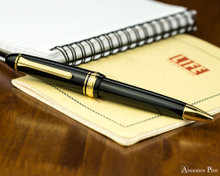 Sailor 1911 Large Ballpoint - Black with Gold Trim - On Notebook