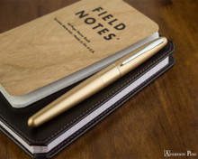 Pilot Metropolitan Fountain Pen - Gold Plain - On Notebook
