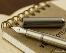 Kaweco Liliput Fountain Pen - Stainless Steel - Open on Notebook