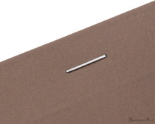 Rhodia No. 18 Premium Notepad - A4, Lined - Taupe staple detail