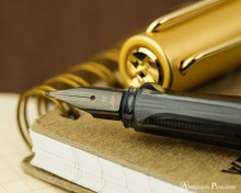 Lamy LX Fountain Pen - Gold - On Notebook Nib