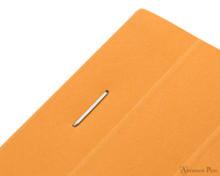 Rhodia No. 18 Staplebound Notepad - A5, Graph - Orange staple detail