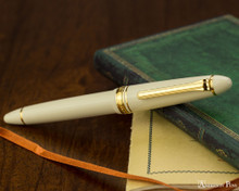 Sailor 1911 Standard Fountain Pen - Ivory with Gold Trim - Closed on Notebook