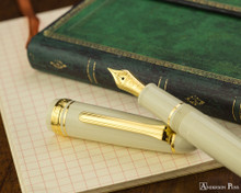 Sailor 1911 Standard Fountain Pen - Ivory with Gold Trim - Open on Notebook