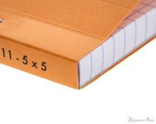 Rhodia No. 11 Staplebound Notepad - 3 x 4, Graph - Orange binding detail