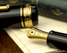 Sailor 1911 Standard Fountain Pen - Black with Gold Trim - Nib on Notebook
